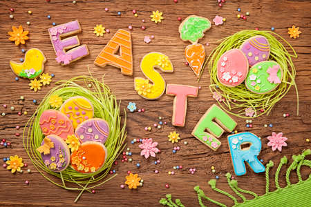Colorful easter cookies on a wooden background Stock Photo - 26508143