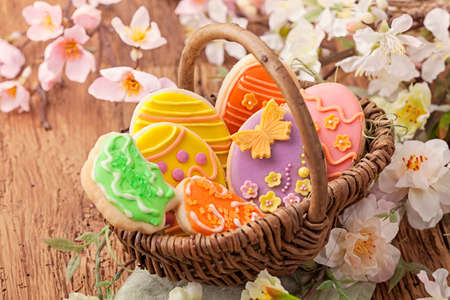 Colorful easter cookies in a basket photo