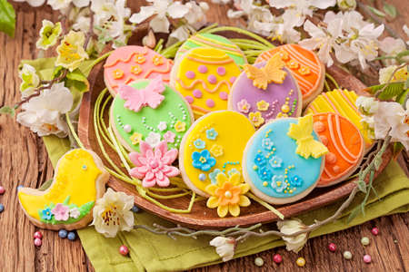 Colorful easter cookies on a plate photo