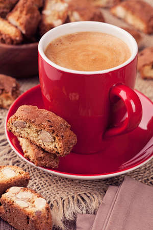 crumbly: Cantuccini and a cup of coffee on a brown  Stock Photo