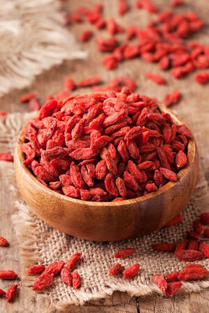 Goji berries in a wooden bowl photo
