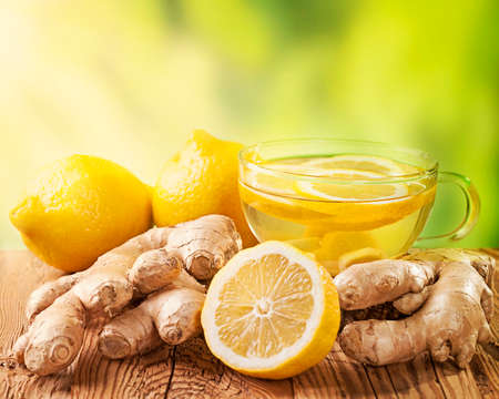 beverage: Ginger tea with lemon on a wooden table