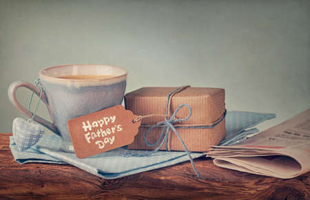 Gift box with a tag and a cup of coffee photo