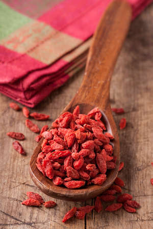 goji berry: Goji berries in a wooden spoon Stock Photo