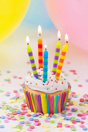 Colorful birthday candles and balloons photo