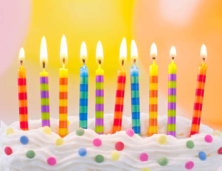 anniversary party: Birthday candles on colorful background Stock Photo