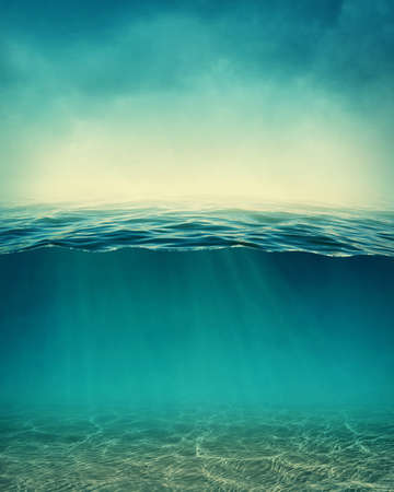 deep ocean: Abstract underwater background with sunbeams Stock Photo