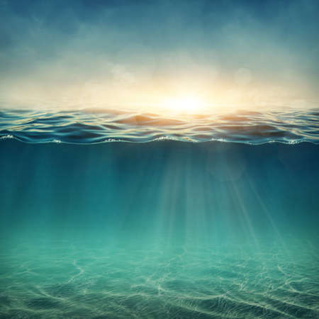 sea waves: Abstract underwater background with sunbeams Stock Photo