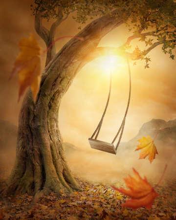 koncept: Stary huśtawka wiszące z dużego drzewa