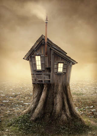 Fantasy tree house in the meadow photo
