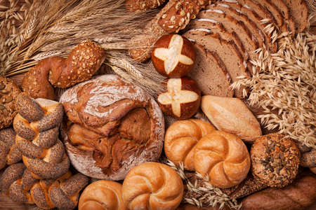 Various bread on a wooden table photo