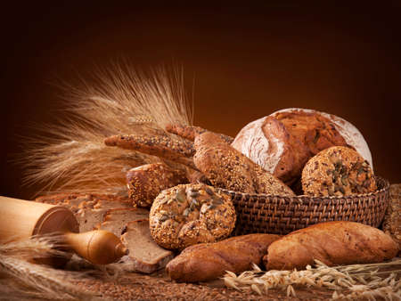 food still: Various bread on a wooden table Stock Photo
