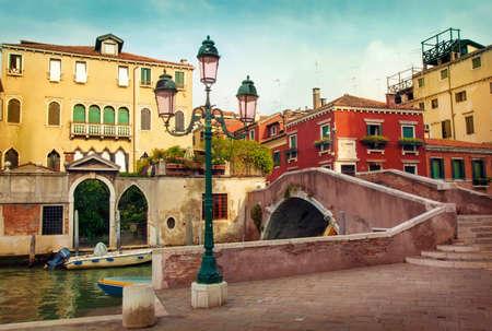 Narrow water canal in Venice, Italy photo