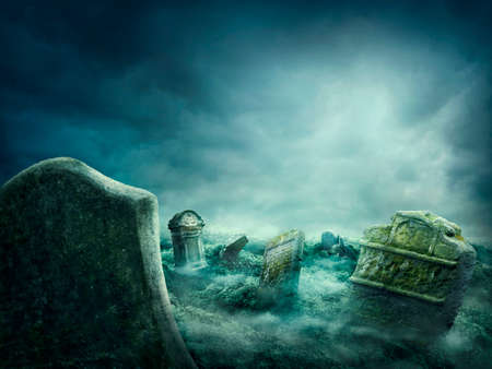 Spooky old graveyard at night Stock Photo