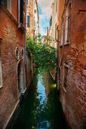Narrow water canal in Venice, Italy photo