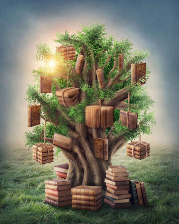 Tree of knowledge in the meadow Stock Photo