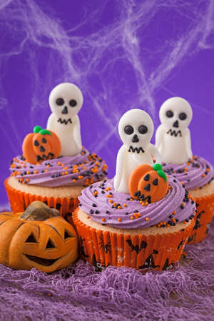 Halloween cupcakes with ghosts and pumpkins photo