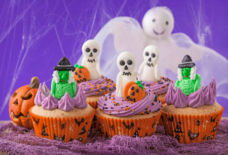 Halloween cupcakes with witches and  ghosts photo