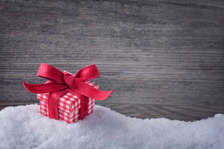 Red gift box on snow Stock Photo