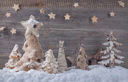 Christmas homemade trees on a wooden background photo