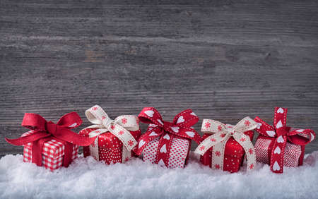 holiday backgrounds: Red gift boxes on snow