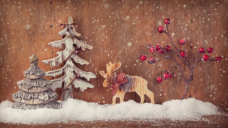 Winter decoration on a wooden background photo