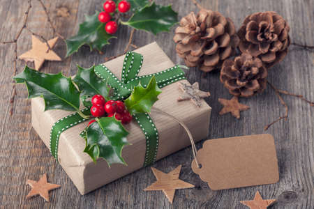 Christmas vintage present on a wooden background photo