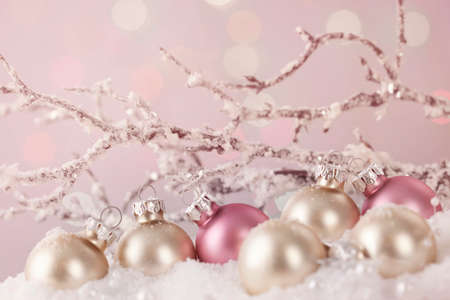 White and pink ornaments on snow