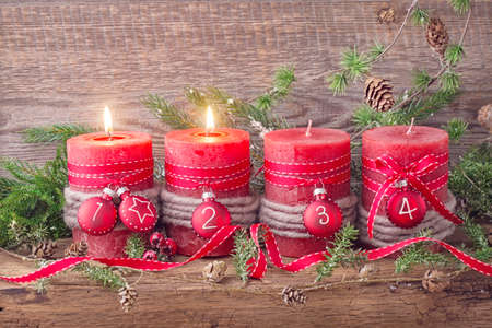 retro christmas: Four red christmas candle for advent