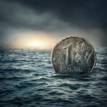 ruble: Ruble coin sinking in water.Russian economic crisis concept
