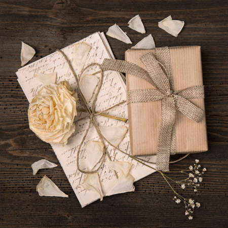 Vintage presents on a wooden background