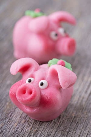 marzipan: Marzipan pig on wooden background