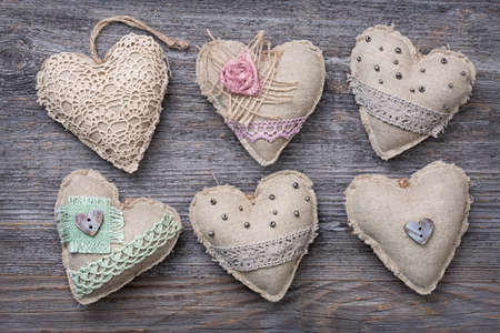 Vintage hearts on a wooden background 스톡 콘텐츠