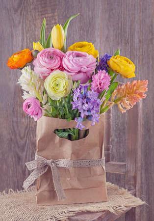 hyacinths: Hyacinths and ranunculus flowers in a bag