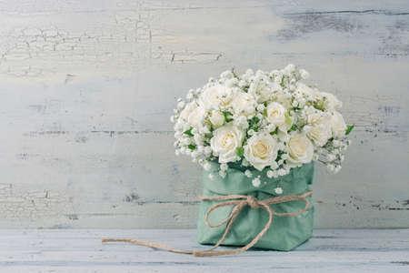 White roses in a green bag Archivio Fotografico