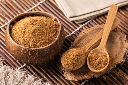 Coconut palm sugar in a bowl Foto de archivo