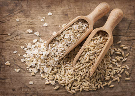 plant antioxidants: Oat flakes and seeds  in spoons