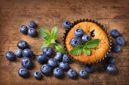 Blueberry muffins in old metal cupcake holder Reklamní fotografie - 43620909