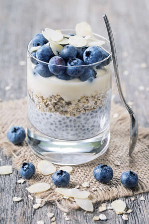 red cup: Chia seeds pudding with blueberries