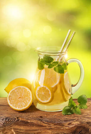 Summer lemon drink on a wooden table Stock Photo
