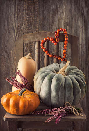 Autumn decoration over a wooden background