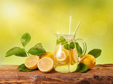 iced tea: Summer lemon drink on a wooden table Stock Photo