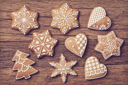 gingerbread cookies: Gingerbread christmas cookies on a wooden brown background