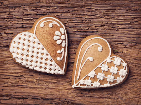 Gingerbread heart cookies on a wooden brown background