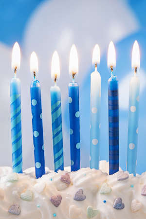 Blue birthday candles and balloons Stock Photo