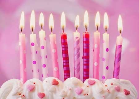 Pink birthday candles and balloons Archivio Fotografico