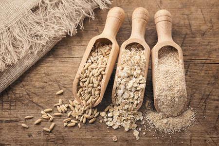 bran: Oat flakes, seeds and bran in spoons