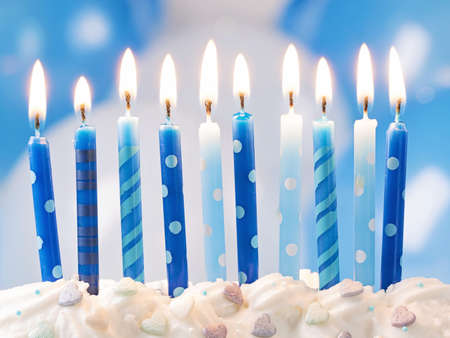 Blue birthday candles and balloons Archivio Fotografico