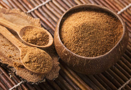 Coconut palm sugar in a bowl Stock Photo
