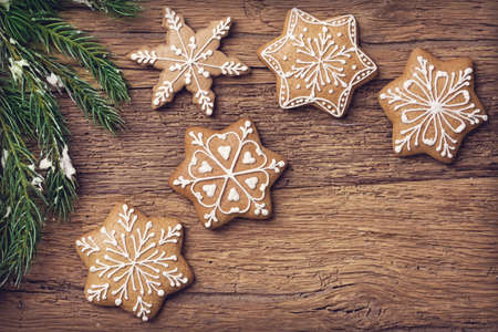 Gingerbread christmas cookies on a wooden brown background